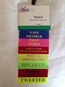 My badge of honor at the NASN 2014 conference.